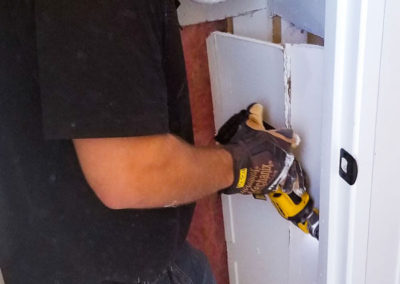 Restoring a wall in a small pantry area.