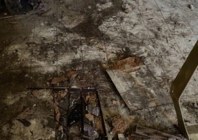 Hazardous asbestos fibers on the floor after an incident.