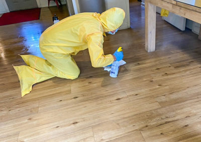 Sanitizing the floor after a biohazard incident.